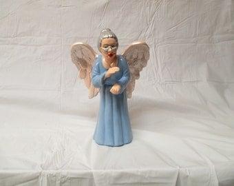 A ceramic bisque grannie angel