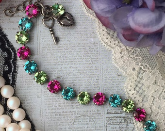 Swarovski crystal bracelet with 8mm fuchsia, turquoise and peridot green crystals.
