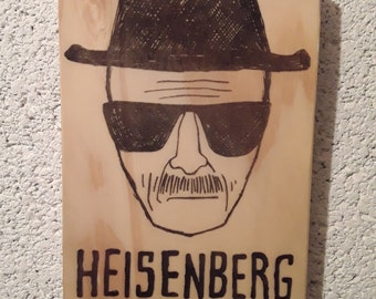 Heisenberg from Breaking Bad TV Show, black ink hand print on an A6 (postcard size) block of reclaimed wood complete with picture hanger.