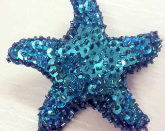 handmade sequin starfish hairpiece in blue.