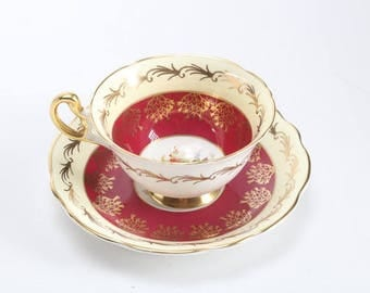 1948 Teacup and Saucer red with gilt ornamentation and white with intricate gilt ornamentation from Foley c 1940 1963