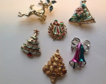 Collection of vintage unsigned holiday brooches