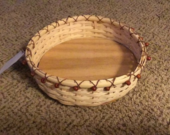 Round flat reed basket trimmed with wood beads
