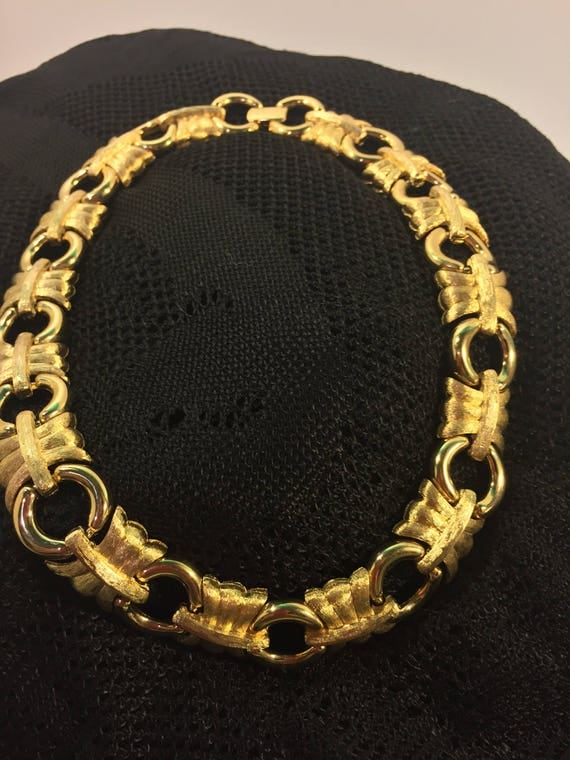 Givenchy New York Paris  signed vintage choker necklace brushed goldtone  iconic  16 inches long  Circa 1980's     125.00