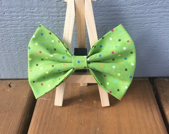 Green bow tie with multi colored dots, dog bow tie