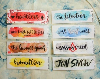 Fandoms bookmarks-Heartless,Illuminae,The Hunger Games, Hamilton, Jon Snow, The Selection,Westworld,the Assassin's Creed