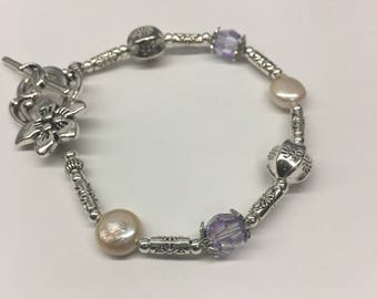 Pearl and purple crystals bracelet  with Lily Flower clasp, size  7.5