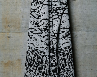 The Black & White Amorf  :  a Scoodie is a long, comfortable scarf combined with an oversized hood