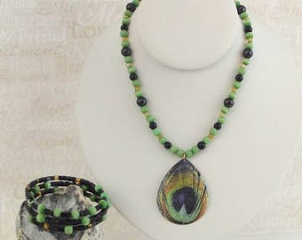 Green, black and gold beaded necklace with matching bracelet