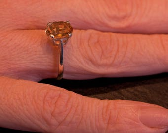 Natural oval cut Citrine set in a silver ring
