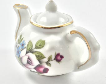 China miniature teapot with floral transfer pattern and gold trim