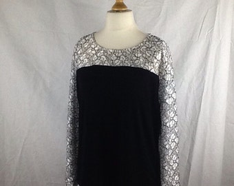 Long sleeve white/silver lace and black jersey top size 12/14