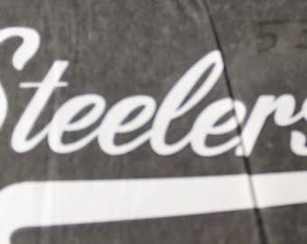 Vintage Pittsburgh  Steelers Iron On Transfer in  white lettering.