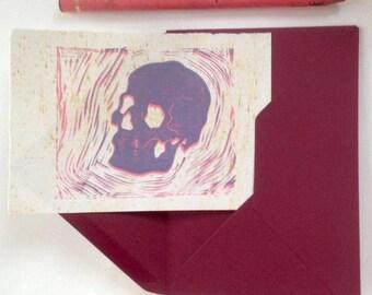Lino printed card, lilac skull