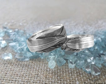 Rings of wedding original and little conventional-rings of feathers