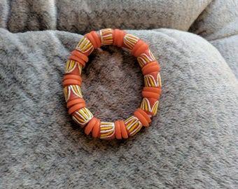 Handmade Ghanaian beaded bracelet Orange Field Design