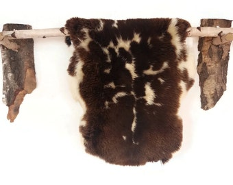 Very elegant sheepskin rug!!!! Prime quality!!!! Luxurious soft hair!!!! Amazing pattern!!! About 90-100cm long!!!