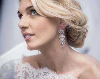 Screw open-work earrings made of cut crystals, hypoallergenic.
