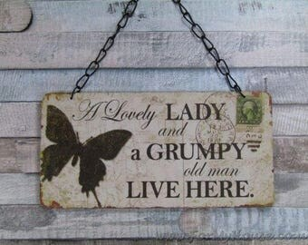 Butterfly A lovely lady and a grumpy old man live here plaque sign SG1139
