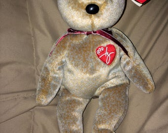 "1999 Signature Bear, Authentic TY Beanie Baby with errors on the tag ""Gasport"" instead of ""Gosport."""