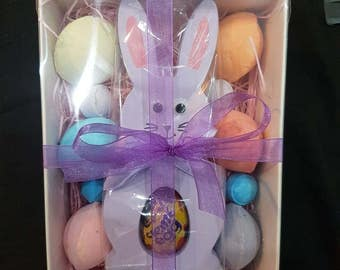 Easter bunny with chocolate egg and bath bombs.