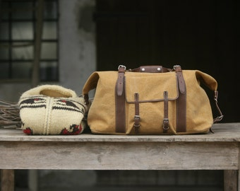 TRINUS: Tuscan leather & canvas travel bag with a SADDLER