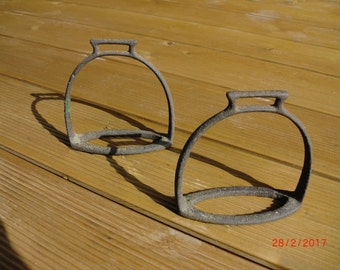 These are two pieces of stirrups for horses that put the saddle on the horse and used to keep the rider's legs.