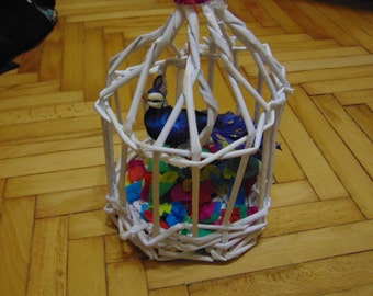 Paper cage with a bird