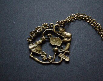 Bronze tone Alice in wonderland garden scene necklace