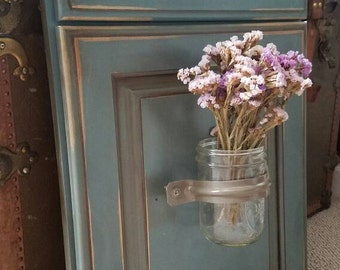 Distressed cabinet flower holder with Mason jar