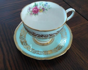 Paragon lt blue and gold tea cup with saucer