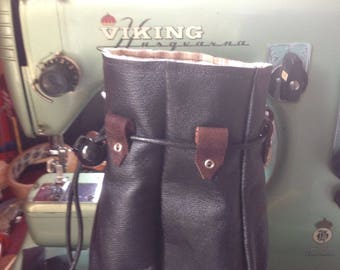 Treasure Keepers, handmade leather pouches. Smartphone size.