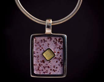Rectangular pendant filled with resin and poppy seeds and sterling inlay