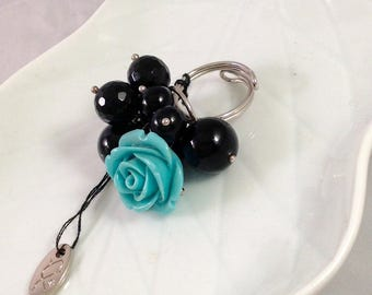 925 Silver and Onyx ring adjustable.