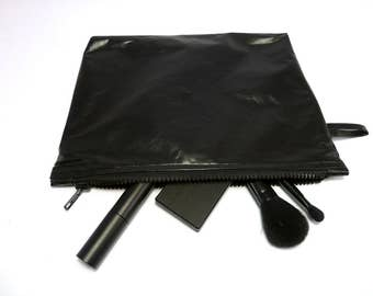 Black oilcloth cosmetics bag