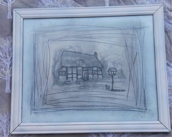 Graphite/pencil style artwork of a cottage scene with a lovely wooden frame