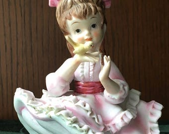 Vintage Lefton Hand Painted Girl with big Bow & a bird on her hand KW 3757