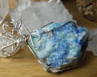 Linarite weaving spider pendant
