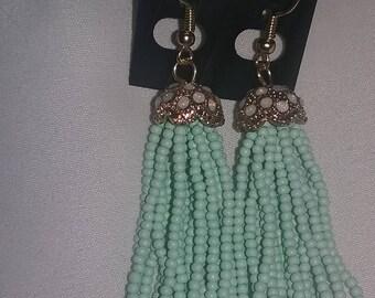 Gold and een dangle earrings