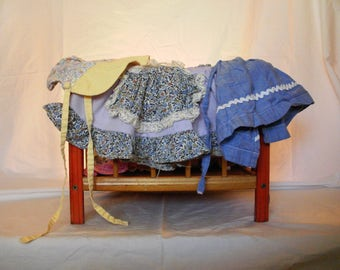 Vintage babydoll playpen with doll clothes