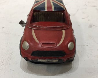 Model mini cooper with union jack flag roof