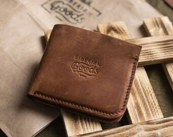 Leather bi-fold wallet with coins