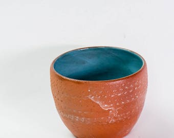 Chunky textured terracotta bowl with white tin wash and duck egg blue interior