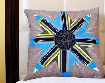 Quilted, colorful, decorative, pillow case in blue, brown and black
