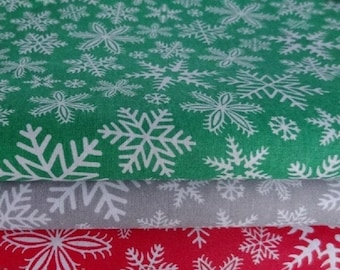 Set of cotton fabrics 50 * 50 cm from 3 pieces: snowflakes on green, gray, red