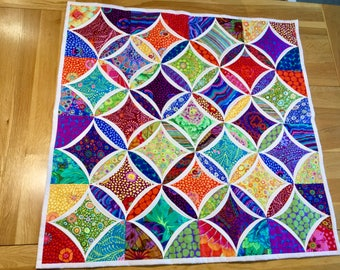 A truly stunning multi-coloured Cathedral Windows quilt
