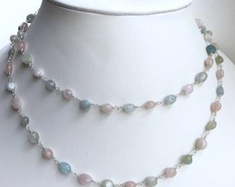 "Aquamarine necklace. Multicolored pastels. 38"" long."