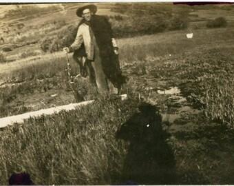 vintage photo Bud Shoots a Wyoming Bear Drapes Skin over his Shoulder w Gun Rifle