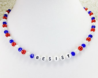 RESIST Necklace with Red, White and Blue Glass Beads and a Silvery Magnetic Clasp