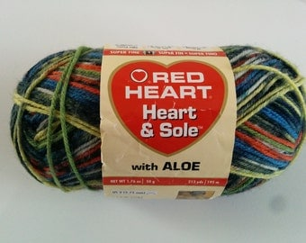 One 50 gram skein Heart & Sole sock yarn in Congo colorway